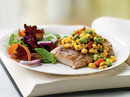 This recipe demonstrates that proper portion size never has to be boring. Four-ounce portions of flavorful mahimahi are simply seasoned and quickly seared, then topped with a delightfully fresh and healthful mix of edamame, corn, and bell pepper for great flavor. It's chock-full of protein and fiber, but contains only 379 calories and 9.4 grams of fat per serving.