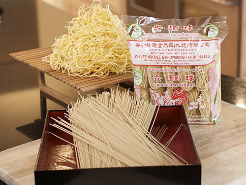 A noodle dish is crucial to Chinese New Year celebrations, since long pasta represents a long life. You'll often find several types of dried Asian noodles at supermarkets, and all manner of dried and fresh varieties at Asian groceries. Just follow the package directions for cooking the noodles before adding them to a stir-fry. Sturdy wheat noodles with added egg, such as e-fu, lo mein, or Shanghai-style noodles, are good candidates. (Back to front: fresh lo mein, Shanghai-style, dried lo mein)