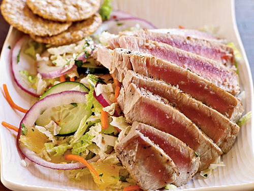 This grilled tuna-topped salad serves two and goes perfectly with a side of crunchy rice cakes for a lighter dinner option. Prepare a refreshing dessert like coconut sorbet and diced mango to follow the spicy salad.