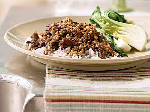 This recipe gives an international twist to a slow-cooker favorite: short ribs. Finished with lime juice and a little zest that adds a bright note, this rich, spicy dish pairs well with bold, fruit-forward, peppery red wines. Serve the saucy ribs over basmati rice and pair with a side of bok choy for a hearty meal.