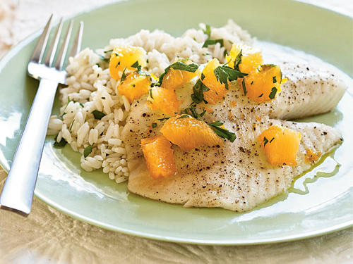 All parts of the orange—juice, rind, and pulp—flavor the quickly cooked tilapia. This recipe calls for white rice as a side dishe, but brown, basmati, and jasmine rice are nice options as well.