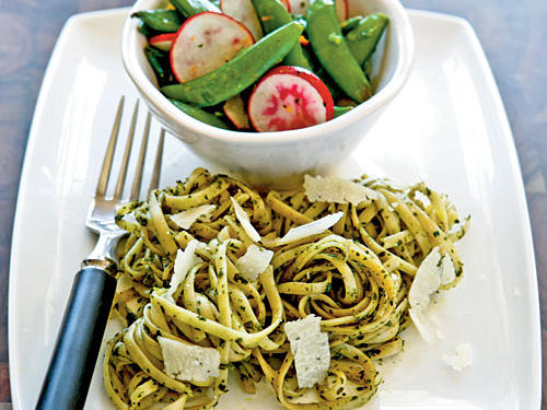Add a peppery bite to your pesto with fresh arugula. Top with freshly grated pecorino Romano and serve with seasonal veggies.