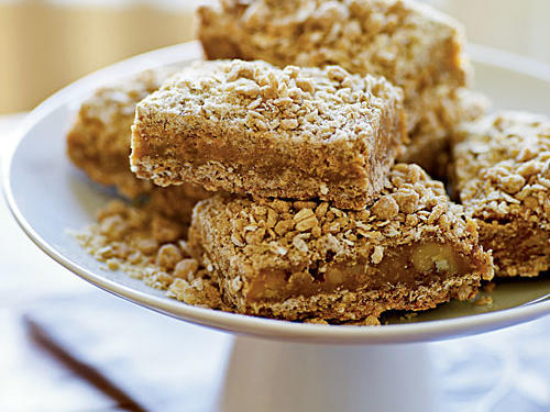 A small square of these rich bars is more than enough to satisfy a dessert craving. Keep that in mind when slicing for the bake sale. The flour and oats mixture is somewhat dry after combining, but it serves as both a solid base for the soft butterscotch chip layer and a crumbly, streusel-like topping.