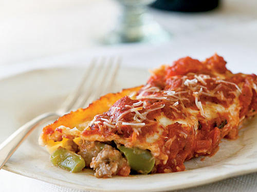 Stuffed manicotti recipes can be high in calories, but turkey sausage and other lower-fat ingredients keep the numbers down in this family-friendly Italian dish.