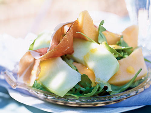 A fresh interpretation of the classic Italian antipasto of melon and prosciutto, this recipe adds arugula to the mix. Ripe cubed cantaloupe ensures a smooth dressing. Prepare vinaigrette a day in advance, and refrigerate.