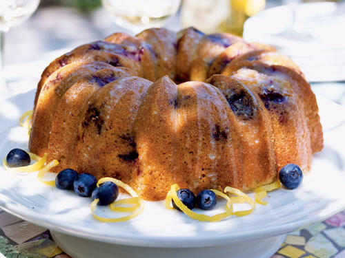 Perfect for an Easter morning brunch, this light cake features sweet, seasonal berries and a lemony glaze. Garnish with ribbons of lemon rind and fresh blueberries.