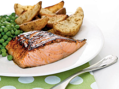 Finish the salmon under the broiler to caramelize the glaze into a tasty browned crust. Serve with roasted potato wedges and peas.