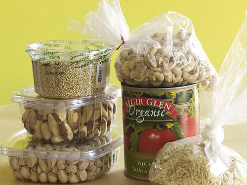"""Foods like grains, pasta, flour, dry beans, nuts, and seeds from bulk bins are significantly less expensive because they don't require costly packaging and labeling,"" says Margaret Wittenberg, global vice president of quality standards for Whole Foods Market in Austin, Texas. Economies of scale also apply to packaged foods. Compare: • 28 ounce can Muir Glen organic whole peeled tomatoes: $0.10 cents/ounce • 14.5 ounce can Muir Glen organic whole peeled tomatoes: $0.14 cents/ounce • Whole Foods bulk bin organic white basmati rice: $4.38/2 pounds • Lundberg organic California white basmati rice: $4.99/2 pounds"