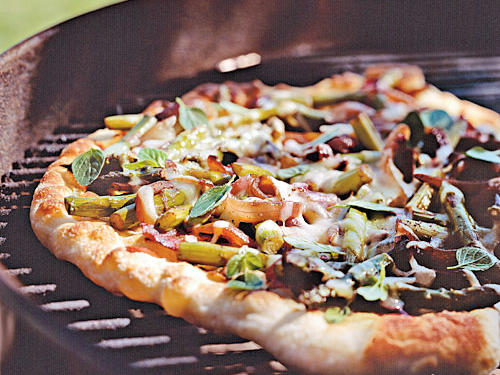 For an out-of-the-ordinary first course, offer guests a wedge of this veggie-topped pizza with smoky flavor from the grill. Start with purchased fresh pizza dough; many supermarkets now offer fresh dough in their delis or bakeries.