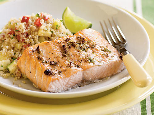 Spice up fish night by giving salmon a delectable 4-ingredient rub before cooking. A quick quinoa-vegetable salad rounds out the meal.