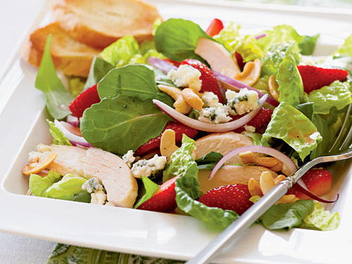 Strawberries don't have to be dessert—you can work them into a main dish, too. Our Chicken and Strawberry Salad is a wonderful no-cook dish that's a snap to make, combining sweet strawberries, tangy vinaigrette, moist chicken, and rich blue cheese.