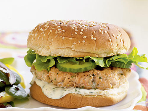 Skip the beef and serve a Mexican-inspired salmon burger topped with a fresh lime-cilantro mayonnaise sauce. A spinach salad with a sweet, slightly spicy Asian-influenced dressing makes a tasty accompaniment.