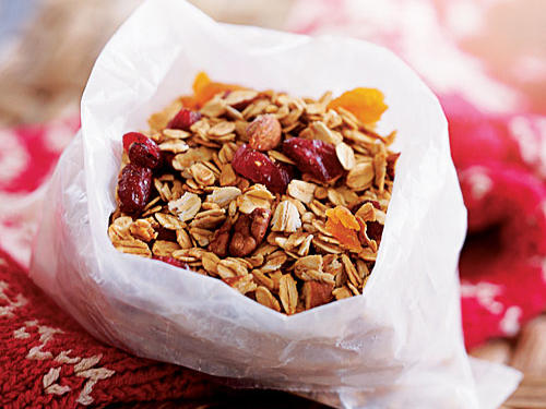 Prepare the granola up to two days ahead, and store in an airtight container. Serve with low-fat yogurt and fruit. If you like your granola super-crunchy, pack the yogurt and fruit in a plastic container and pack your granola in a zip-top bag. Mix when you are ready to dig in.