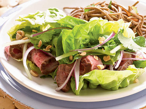 Fill crisp lettuce leaves with sliced flank steak topped with a zesty sauce made from lime juice, brown sugar, and minced pepper. Soba noodle salad complements the meaty wraps and brings another texture to the plate.