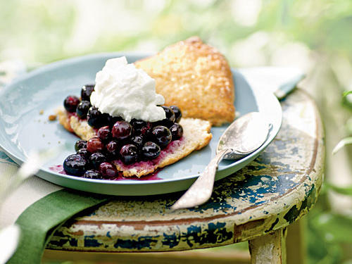 Blueberries signal the arrival of summer's sweetest days, and this dessert highlights them perfectly. Crumbly shortbread and homemade whipped cream elevate a simple berry to a memorably indulgent treat. The components of this dish can be made in advance, then assembled just before serving.