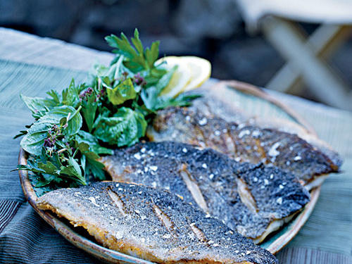 Whether prepared over the campfire beside your favorite fly-fishing stream or in the comfort of your kitchen, this dish exemplifies the great but often overlooked flavor of trout. The crisp skin and flaky fish are balanced by the easy salad of nothing but herbs, lemon juice, and salt.