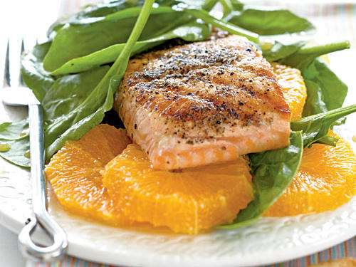 The citrus vinaigrette blends well with the smoky salmon, sweet orange slices, and crisp spinach in this super fast, super healthy recipe.