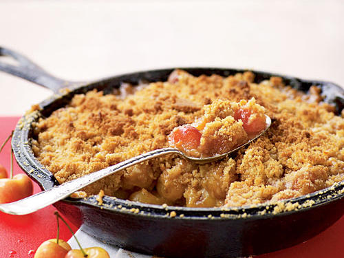 Rainier cherries are sweet enough on their own that the filling for this crumble needs no extra sugar. The topping is crunchy and nutty, and the filling is sweet, warm, and gooey, for a perfect comforting dessert. You don't even need a cherry pitter: Hit each cherry with the flat side of a chef's knife (like crushing garlic cloves), and the pit pops right out.