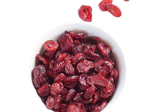 Health benefit: Adding 1/4 cup of dried fruit (like cranberries, raisins, or figs) to your diet counts as one of the two to four servings of fruit you're supposed to be getting each day.