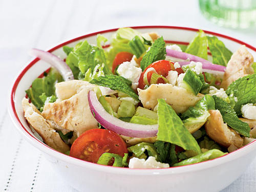 This recipe is similar to fattoush, a Lebanese bread salad. Traditionally, the bread is fried; here, it's crisped in the oven. Shredded cooked chicken converts it to a main course.