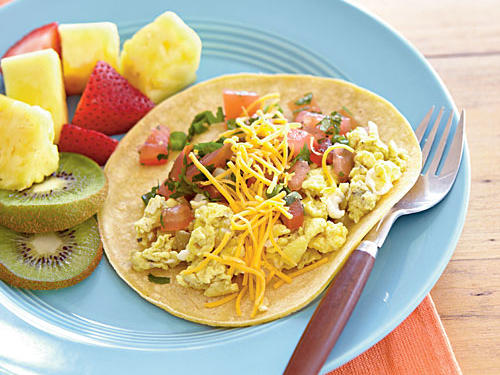 This quick and healthy burrito is a great way to get kids to eat breakfast, even if they are dashing toward the bus stop.
