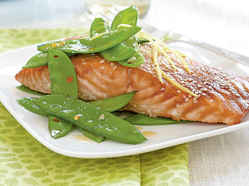 This five-ingredient salmon marinates for eight minutes then cooks for eight minutes and is guaranteed to please. Enjoy garlicky-spicy snow peas on the side.