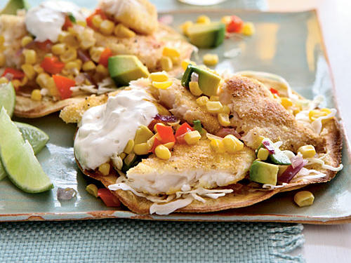 These crisp tilapia tostadas have all the appeal of traditional fish tacos, but the flat shape allows you to pile toppings high. Although we broil corn tortillas for the base, substitute flour tortillas, or use prepared shells, if you prefer.