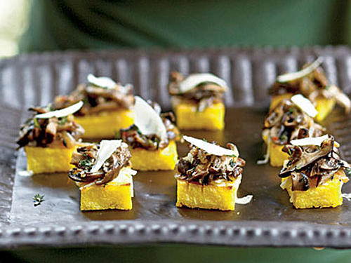 Nutty Gruyère cheese complements earthy mushrooms in these canapés. Make these a day ahead by preparing and chilling the polenta and mushroom mixture. When ready to serve, broil the polenta for a quick time saver.