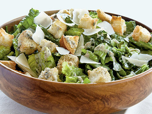Lighten up a traditional Caesar salad dressing by replacing some of the oil with fat-free yogurt. The red wine vinegar, anchovy paste, and Worcestershire sauce guarantee plenty of flavor.
