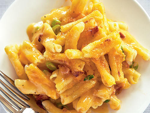 This macaroni and cheese meal is sure to gather rave reviews from kids and adults alike. This family-friendly one-dish meal gets it richness from sharp cheddar cheese, which mellows the heat from the hot sauce.