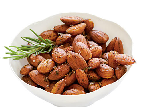Fresh rosemary gives wonderful fragrance and flavor to this roasted almond recipe, and chili powder provides just the right amount of spiciness. Serve at a party or as an everyday snack.