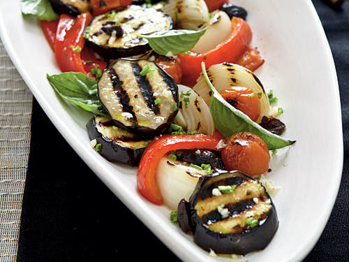 Although you can successfully prepare this colorful end-of-summer salad on a gas grill, charcoal will imbue the vegetables with extra flavor. You can easily substitute white wine vinegar for the champagne vinegar without compromising the flavor of the dish.