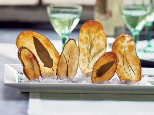 A mandoline will help you create picture-perfect chips. Tip: Buy an extra potato to practice with beforehand.