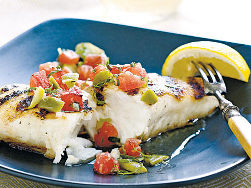 Mild halibut pairs nicely with this tangy relish, starring tasty late-summer tomatoes. Any other meaty, firm fish, such as wild salmon or striped bass, will also work.
