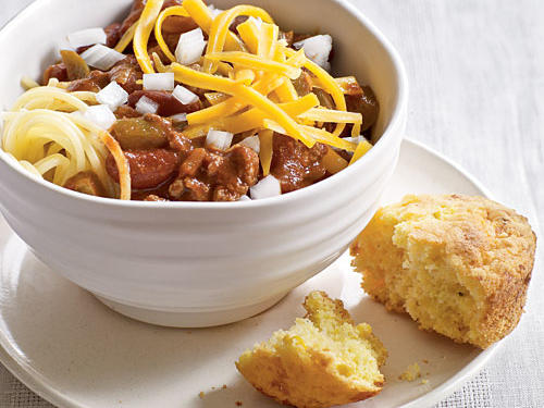 You'll love this hearty Midwestern take on chili, where the soup serves as a chunky sauce for a bed of spaghetti noodles. The chili itself is a quick and easy turkey version, flavored with the warmth of cumin, cinnamon, and allspice and bulked up with kidney beans and diced tomatoes. A touch of chocolate is a classic Cincy touch; think of it, plus the sweet spices, as taking the chili in a rich, delicious Mexican mole direction (don't worry—it's not too sweet). The bite of crunchy raw onions and the sharp tang of cheddar cheese are perfect finishing touches.