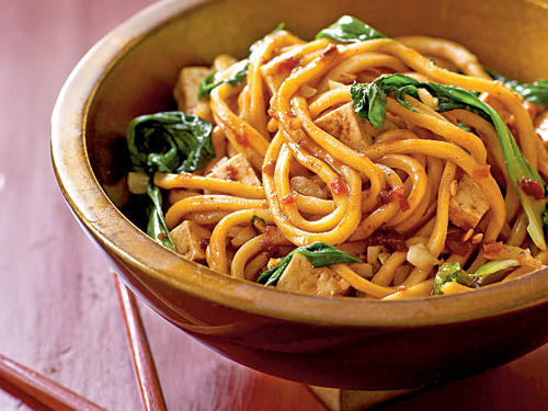 The Noodle: Malaysian food is a melting pot of flavors and traditions. Here Chinese lo mein egg noodles star in this spicy stir-fry. Their dramatic length and chunky texture make them perfect for the thick sauce.The Sauce: Blazing chile paste and sweet bean sauce, a salty-sugary brew of fermented soybeans, mix to render incomparable flavor. The latter is usually available at Asian markets; try hoisin sauce or kecap manis if you can't find it.The Extras: Sautéed baby bok choy adds a slight crunch, and its little green leaves perk up the color of this bowl. Drain extra-firm tofu, cut it into chunks, and toss with the noodles to boost protein and cut the heat.