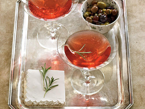 This simple twist on the traditional kir royale blends tart-sweet pomegranate juice with subtle herbal notes from a rosemary-infused syrup. Float rosemary leaves on the drinks for a pretty garnish.