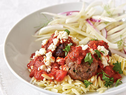 This riff on spaghetti and meatballs uses rice-shaped pasta, ground lamb, and feta cheese.