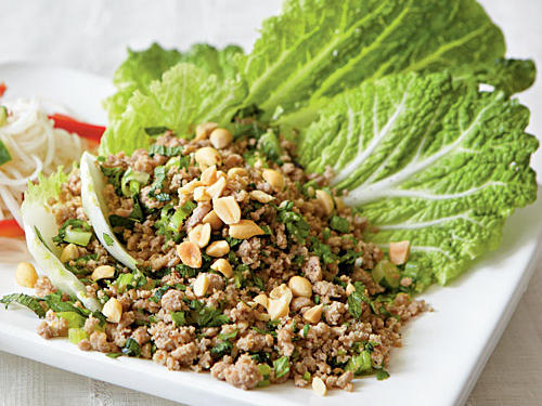 Our twist on larb, a Thai/Laotian salad of meat flavored with lime juice, herbs, and chiles, delivers a huge amount of flavor. The turkey and peanuts create a textural contrast of crunchy and chewy, while the lime, fish sauce, and jalapeños make a wonderfully spicy mixture whose heat is moderated by cooling Napa cabbage. Serve with a bottle of Sriracha so spice lovers can add extra heat to their portions.