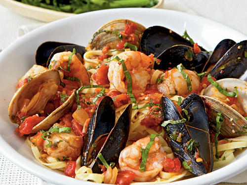 "Italian for ""angry,"" arrabbiata is a spicy tomato sauce. For true fury, use 1/2 teaspoon crushed red pepper in this delicious seafood dish."