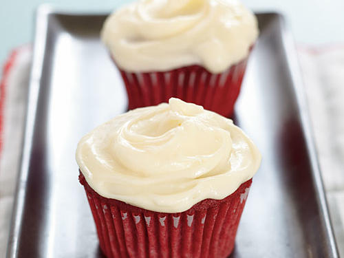 The frosting takes this red velvet cupcake recipe from great to fantastic. The secret? Use real butter and real cream cheese. The results are mouthwateringly good. Recognizable by it's vibrant hue, red velvet cupcakes carry a rich, decadent chocolate flavor that stands up perfectly with a thick cream cheese frosting. Whether the occasion is a birthday, Valentine's day, or a dire chocolate emergency, this beautiful cupcakes are the perfect indulgent treat. Make sure to let the cupcakes completely cool once taken out of the oven so that the heat does not compromise the flavor and texture of your cream cheese frosting.