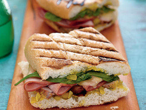 Citrus-laced mojo and tangy relish add big flavor to these Cuban Sandwiches.