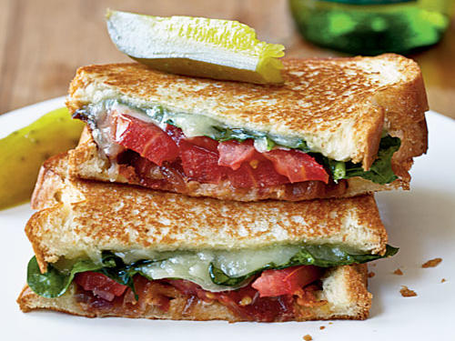 A new take on a familiar favorite pairs grilled cheese with a BLT for a luscious veggie-packed sandwich that feels like an indulgence. Serve with zesty dill pickle spears.
