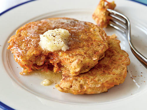 Stuffed with toasted walnuts, shredded carrots, and all the spices found in carrot cake, these light buttermilk pancakes are a guilt-free breakfast pleasure. Top with some homemade honey butter or light pancake syrup.