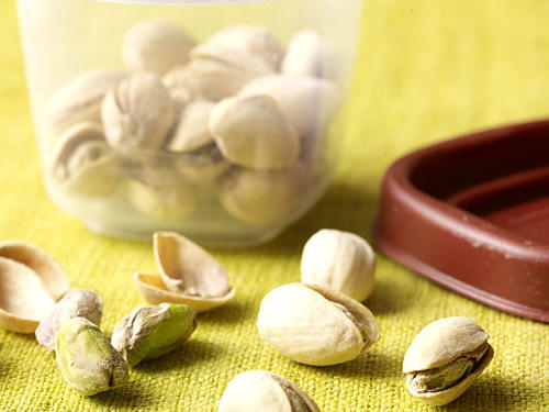 In-shell pistachios are a good low-cal source of protein, with a filling 6 grams of protein per ounce and only 100 calories per 30-nut serving. Researchers at Eastern Illinois University reported that eating in-shell pistachios resulted in eating 41% less calories compared to those who ate shelled nuts. The logic is that the nuts' shell helps to trick the brain into thinking that you've eaten more than you actually have. For a super satisfying snack that won't weigh you down, keep a bag of these unshelled nuts handy.
