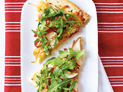 "Peppery arugula resting on a base of creamy, sweet caramelized onions brings pizza to a whole new level in this surprisingly quick and healthy pie. You can have this version ready in the time it would take to have one of those weighed-down pizzas delivered to your door. Vanessa Pruett, Test Kitchen Director names this one of her favorites: ""I love the idea of pizza and salad combined. And a premade crust makes it easy."""