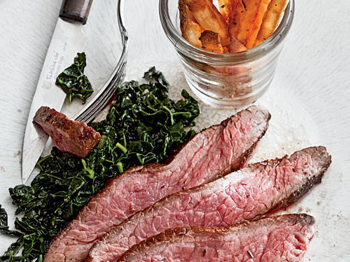 Kale is perfectly paired with Cajun-seasoned steak and potato frites—all for under 400 calories per serving.
