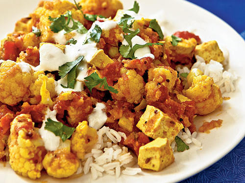 This dish is a riff on the Indian dish aloo gobi, with tofu standing in for traditional potatoes. Sprinkle with cilantro for a burst of distinctive fresh flavor.