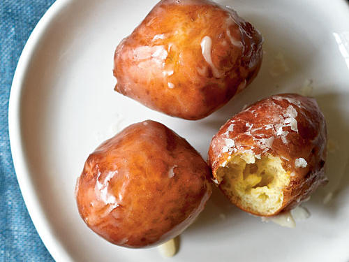 Sour cream enriches these yeasted doughnut holes. Enjoy them for breakfast or dessert. Sugarcoat it: Omit the maple glaze and dip the doughnut holes in a mixture of granulated sugar and ground cinnamon for more texture.