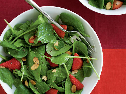Use organic, locally grown strawberries in spring when you can find them. Their intensely sweet flavor, combined with the mint and vinaigrette, makes this salad sublime.